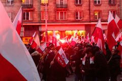 Independence Day March in Warsaw Poland Marred by Violence and Controversy. Protesters walk down the road waving flags and flares at the annual Polish Stock Photo