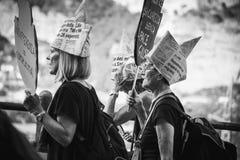 Protesters women withanti racism slogan stock photo