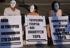 Protesting in Athens. People wearing white masks are protesting in the capital of  Greece Athens outside the Parliament building on the 9th of May, 2010, against Stock Images