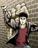 Protesting boy. Illustration with boy who raised fist staying against the brick wall drawn in placard style royalty free illustration