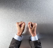 Protesting businessman fists for corporate power, conviction, frustration or impatience Stock Photo