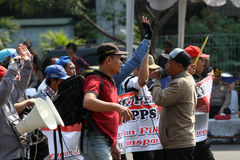 Protesting. Demonstrators protesting reject the election results in the city of Solo, Central Java, Indonesia Royalty Free Stock Images
