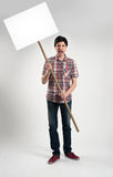 Protesting man with placard. Screaming Stock Photography