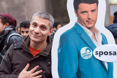 Protestor ironic with Premier Renzi Stock Photography
