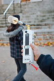Protestor measures radiation from Videotron Antenn. Montreal-North, Quebec, Canada October 25, 2009 Demonstrator uses an HF Analyzer in front of the St-Vital Royalty Free Stock Photo
