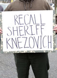 Protestor's sign. Spokane, Washington USA - December 20, 2014. A close up of a sign calling for a recall of Spokane, County Sheriff Stock Photo