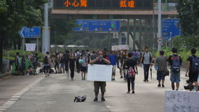 A protestor standing at Umbrella Revolution in Hong Kong Stock Images