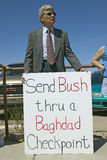 Protestor in Tucson Arizona. Of President George W. Bush holding a sign protesting his Iraq foreign policy Stock Photo