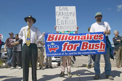 Protestor in Tucson Arizona of President G Bush. Protestor in Tucson Arizona of President George W. Bush holding a sign proclaiming Billionaires for Bush Stock Photography