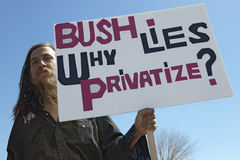 Protestor in Tucson Arizona of President George W. Bush holding a sign protesting his Iraq foreign policy Stock Photos