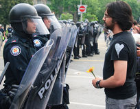 Protestor uses Flower facing Police G8/G20 Toronto stock photos