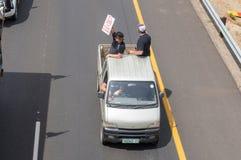 Protestors at Bloemfontein protesting against farm attacks. BLOEMFONTEIN, SOUTH AFRICA - OCTOBER 30, 2017: Protestors on the N1-highway at Bloemfontein royalty free stock photos