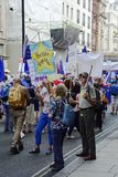 London, England. June 23 2018. People`s Vote protest march. Protestors carrying flags and placards including the European Union flag, taking part in the People`s Royalty Free Stock Photos