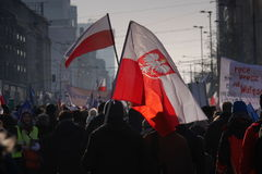 Protestors carrying flags on the streets of Warsaw Stock Photography