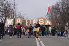 Protestors carrying 'Walesa' banner Stock Image
