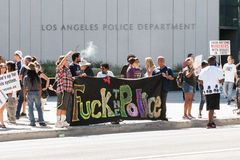 Protestors hold a banner outside LAPD headquarters. Downtown protesting the killing of Ezell Ford on August 17, 2014 Royalty Free Stock Photos