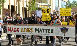 Protestors participating in  the George Floyd Black Lives Matter protest in Alameda, CA