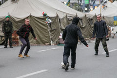 Protestors play football. Euromaidan, Kyiv after protest 10.04.2014. Euromaidan, Kyiv after protest 10.04.2014 Royalty Free Stock Photo