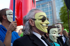 Protestors wearing Guy Fawkes maskes during manifestation against the trade agreements TTIP and CETA in Brussels Royalty Free Stock Photography