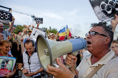 Protests in Bucharest Romania. People shout during a rally in Bucharest, protesting against Romania's President Traian Basescu, after romanian lawmakers debated Royalty Free Stock Images