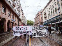 Protests in France against Macron Reforms let`s be revolutionary. STRASBOURG, FRANCE - SEP 12, 2017: Let`s be revolutionary placard hold by people during a Stock Photos