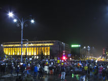 Protests in Romania against corruption. Large crowds of Romanian people have gathered  in front of Government building to protest against abuse in regard to Stock Photography