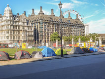 Protests and supporters pitch up tents at Parliament Square, Lon Stock Image