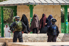 Protests on Temple Mount in Jerusalem. JERUSALEM, ISRAEL - JULY 26, 2015: Group of palestinian women in niqab protest in Old City of Jerusalem against ascent of Royalty Free Stock Photography