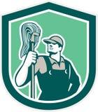 Protetor de Cleaner Holding Mop do guarda de serviço retro ilustração royalty free