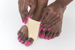 Protezione di borsite dell'alluce del piede della donna Immagini Stock