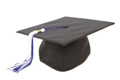 Protezione di graduazione con la nappa bianca blu Fotografia Stock