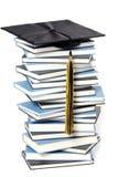 Protezione e libri di graduazione Immagini Stock Libere da Diritti