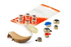 Prothèse auditive et batterie Photographie stock libre de droits