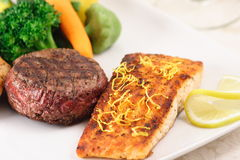 Protien rich meal. Gourmet plate made with wild caught salmon and hormone free beef that is natural food Stock Images