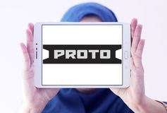 Proto Tools company logo. Logo of Proto Tools company on samsung tablet holded by arab muslim woman. Proto Tools is an American industrial hand tool company. The Stock Photography