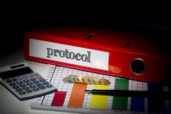 Protocol on red business binder Royalty Free Stock Photo
