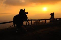 Protographer met zonsondergang Stock Foto's
