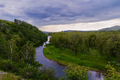 Protoka of the Yenisei. Cloudy summer day. One of the sleeves of the Yenisei River flowing along the low hills. Khakassia. Summer 2014. June Stock Photo
