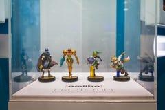 Prototipos de Nintendo Amiibos en la exhibición en la semana 2014 de los juegos en Milán, Italia Imágenes de archivo libres de regalías