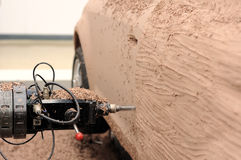 Prototype machine. Close up of prototype machine do the vehicle clay model Stock Images