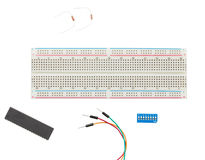 Prototype Solderless electrical Breadboard. With Jumper cable, resistors, toggle switch isolated Royalty Free Stock Image