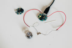 Prototype of a wearable device with a home-made sewable microcon. Troller, conductive wire and led sewable Royalty Free Stock Photography