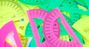Protractor. More colored protractor in white background stock photos