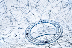Protractor. On the background of mathematical formulas and algorithms stock photo