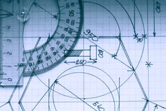 Protractor On Graph. Closeup of protractor on graph paper with draft stock image