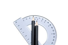 Protractor and pencils Royalty Free Stock Image