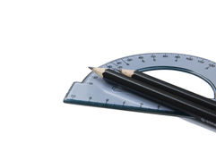 Protractor and pencils Royalty Free Stock Images