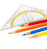 Protractor and pencils. Back to school. Protractor and pencils isolated on a white background royalty free stock image