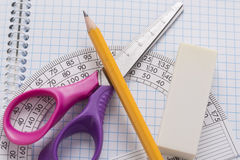 Protractors, scissors, pencil, eraser Royalty Free Stock Photo