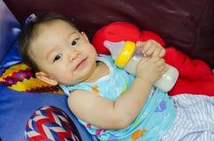 Protrait of baby boy with milk bottle Stock Photos